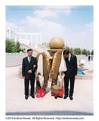 Turkmen Wedding (Rowat) Tags: wedding wallpaper film wall twins kodak assignment covered tm 67 turkmenistan ashgabat 2star 1star rowat traditionalgarb walkofhealth andrewrowat slideluckpotshowtoronto2009 turkmenwedding turkmenbashieternallygreatpark eternallygreatpark