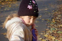 Naughty (odeku03(Children and others)) Tags: park autumn portrait girl face look childhood yellow kids children toys eyes doll day child bright littlegirl emotions dasha gettyimagesrussiaq2