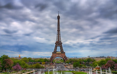 Tour Eiffel (Jim Boud) Tags: travel blue france colors clouds canon eos cloudy dslr digitalrebel photoart digitalslr hdr highdynamicrange xsi artisticphotography partlycloudy multipleexposures blendedexposure photomatix eos450d jimboud photomatixhdr kissx2 jamesboud