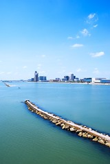 Corpus Christi bay (Jim Nix / Nomadic Pursuits) Tags: ocean travel blue sky green beach gulfofmexico water skyline clouds bay sand nikon cityscape texas gulf corpuschristi tx jetty nomadicpursuits