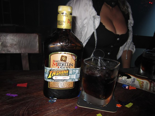 Bottle of Ron Medellin Anejo (rum) at a discoteca. The cost of travel in Colombia will vary based on the amount of partying one does.
