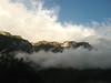nuvole e ombra, cielo e monti