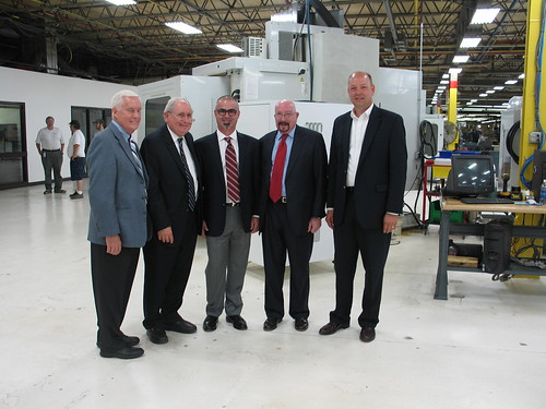 (From left):  SMI Co-owner Jerry Carlson, U.S. Sen. Carl Levin, SMI President Dodd Russell, USDA Rural Development State Director for Michigan James J. Turner, and The Bank of Northern Michigan Vice President for Business Banking Wade Van Houzen.