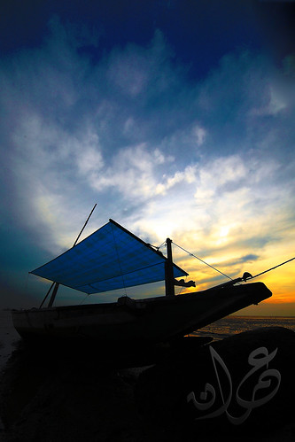 Boat silhouette during sunset