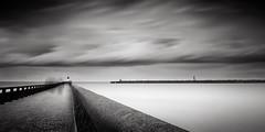 Calais Pier Ghosts (Joel Tjintjelaar) Tags: pier calais bwphotography daytimelongexposure nd110 bwnd110 tjintjelaar france2010