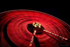 big wheel keep on turnin' (helen sotiriadis) Tags: longexposure light red motion black public wheel night canon circle fun published ride trails athens greece ferriswheel amusementpark lighttrails tilt canonefs1022mmf3545usm canoneos40d alloufunpark updatecollection