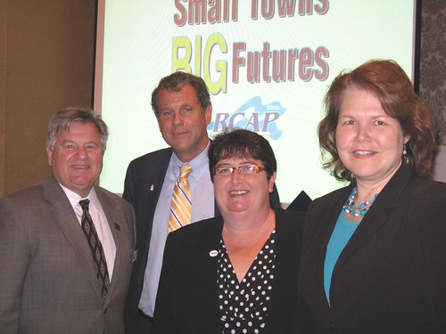 (Left to right) Ohio Rural Development State Director Tony Logan, Sen. Sherrod Brown, Deb Martin, Great Lakes RCAP Director and Judith Canales, USDA Rural Development Administrator for Business and Cooperative Programs at the Ohio RCAP conference.