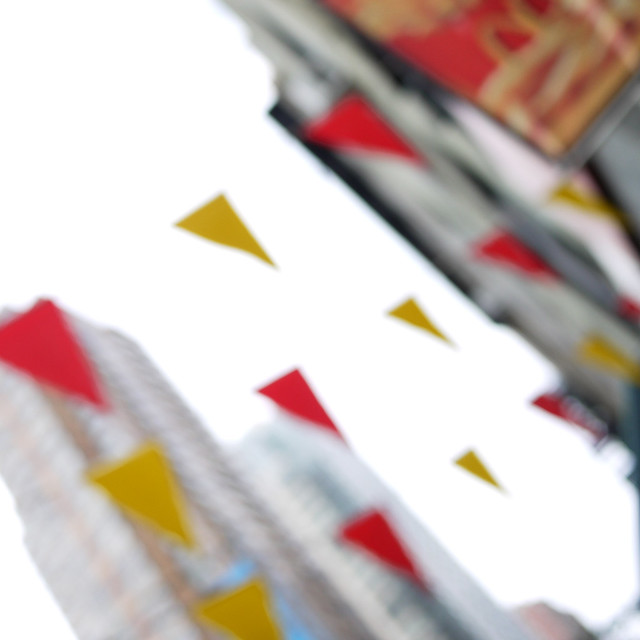 unfocused triangle flags flying by #walkingtoworktoday