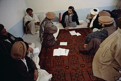AAEC001270 (Memories of Massoud) Tags: people afghanistan men wool clothing asia asians military muslim several jacket males prominentpersons leader posture cloth kneeling adults guerrilla afghans outerwear militarypersonnel militaryofficer governmentofficial mujahideen politicalleader centralasians militaryleader takharprovince ahmedshahmassoud khojabahauddin