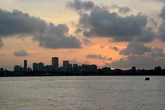 Mumbai Skyline-2 (sanmang610) Tags: city travel sunset sea orange sun india color colour tourism water horizontal architecture clouds buildings landscape evening boat colorful asia view shade maharashtra colourful arabian mumbai skycrapers