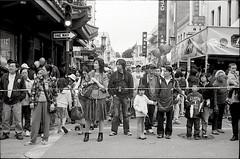stay behind the line, please. (Suguru Nishioka) Tags: sanfrancisco people bw film festival chinatown traffic neopan400 nocrop nometering rodinal1600 nogearinfo