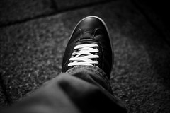 (Photographymax) Tags: white black field lens concrete photography foot shoe 50mm photo clothing dof bokeh grain olympus right system wear jeans denim tied om 18 zig lacoste zuiko depth trainer laces zag swivel