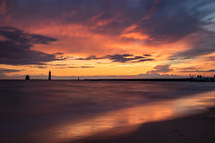 Grand Haven sunset...... (Kevin Povenz Thanks for the 3,300,000 views) Tags: 2017 july kevinpovenz westmichigan michigan ottawa ottawacounty grandhaven grandhavenpier grandhavenstatepark shore shoreline lakemichigan lake water waves longexposure clouds sunset color colorful canon7dmarkii reflection evening eveningsky dusk yellow orange beach