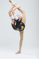 Sport concepts and Ideas. Young Caucasian Female Rhythmic Gymnast Athlete In Professional Competitive Suit Doing Vertical Split  and Backbend While Posing in Studio Against White. (DmitryMorgan) Tags: 1 711years active aerobics art artistic athlete beautiful bend body bodysuit caucasian champion child childhood colorful dynamic elegant exercise female fitness flexible gimnastika girl grace gymnast gymnastics healthy individual lady lifestyle one preschooler professional rhythmic rhythmicgymnastic rhytmic split splits sport sportswear sportswoman sporty stretching studio training wellbeing wellness