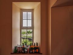 sunday morning (lowooley.) Tags: northpennines northumberland sinderhopecommunitycentre windowsill bottles empty