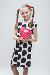 Portrait of Funny Caucasian Blond Girl With Pigtails Posing in Polka Dot Dress Against White. Holding Red Air Balloon. (DmitryMorgan) Tags: 1 710years adorable airballoon baby beautiful blond blowup caucasian cheerful child childhood daughter dress european expression female fun girl heartformed holding human inflate joy kid little love model mood one pigtails polkadot portrait positive preschooler school schoolgirl small smile smiling straw studio white young