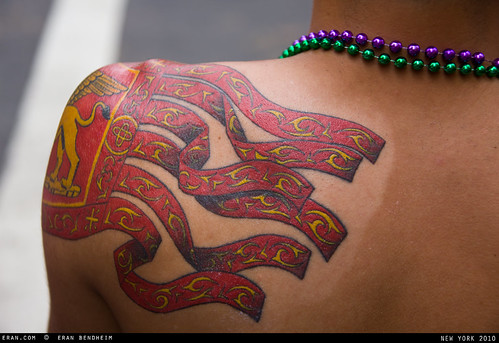 tatto red and yellow and beads