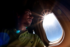 Staring Down from A Mile Above (clay.oster) Tags: portrait sun green window plane lens cabin fisheye flare polo