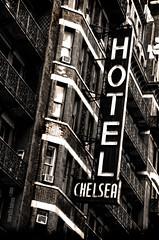 Chelsea Hotel (f1design) Tags: nyc newyorkcity blackandwhite bw ny newyork sign vertical sepia hotel blackwhite neon manhattan highcontrast icon signage iconic sepiatone newyorkny gothamcity chelseahotel hotelchelsea neonsignage f1design