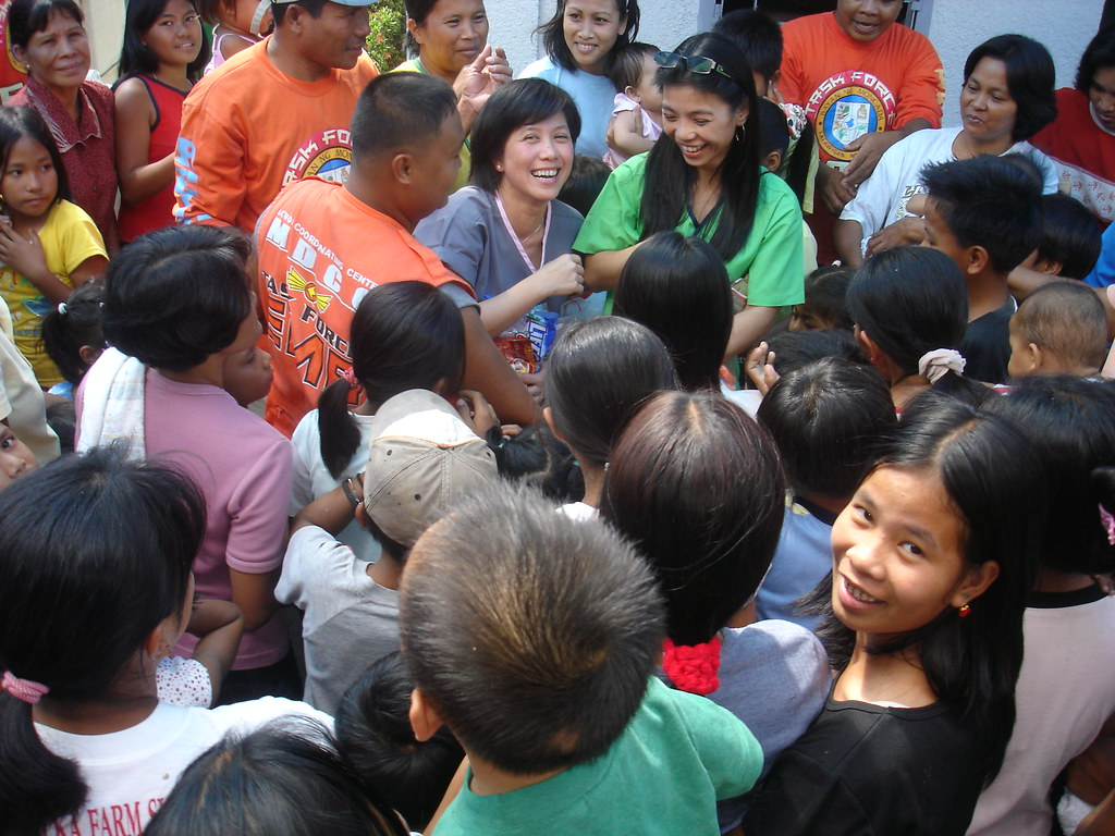 Thu Aram and Maria Sison-Wright, RPT distributing toys to the children