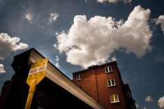 Summer In the City : Last Stop Before the Clouds (Gilderic Photography) Tags: street city blue sky urban cloud fish building bus brick window field yellow wall architecture clouds jaune rouge lumix europe raw belgium belgique belgie dream panasonic bleu ciel stop brique nuage rue poisson mur liege luik tec fenetre immeuble lightroom gilderic lx3 dmclx3