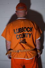 LUBBOCK_1284 (skinmate) Tags: orange inmate restraints
