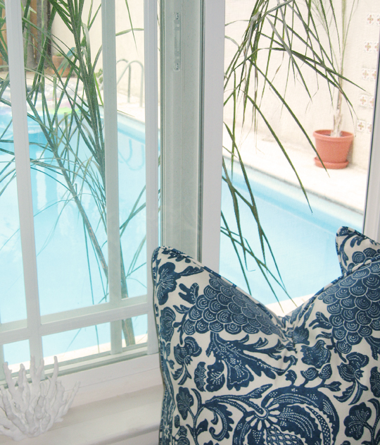 Bedroom Window+Barclay Butera Pillows+Palms+blue and white floral print+faux coral