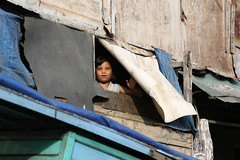 A Look Outside (welshby) Tags: poverty child canvas canonef2470mmf28lusm slum tarp buiding