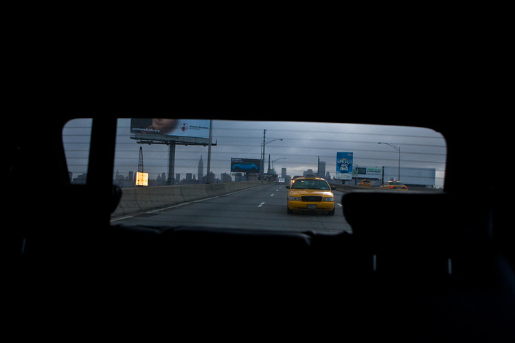 Cabs Rolling to JFK with Empire State Building behind : Queens : NYC
