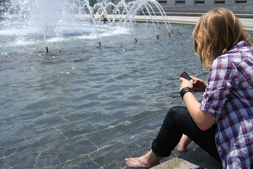 7/16/10 - Cooling off at the WWII Memorial - cell in hand at all times