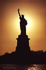 The country of the raising sun (Mia :)) Tags: nyc sunset shadow sun america canon freedom sundown statueofliberty silhuette worldwidewandering