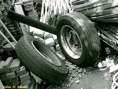 Anybody need a spare (nrhodesphotos(the_eye_of_the_moment)) Tags: wood metal yard junk bricks wheels rubber tires rims piles sparetires treads nrhodesphotosyahoocom wwwflickrcomphotostheeyeofthemoment theeyemomentphotosbynolanhrhodes dscn6239nhrt