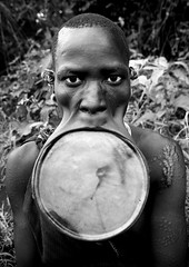 Surma woman with giant lip plate - Kibish Ethiopia (Eric Lafforgue) Tags: woman girl artistic culture bodylanguage tribal ornament clay tribes bodypainting tradition tribe ethnic rite surma scars scarification bodymodification tribo labret adornment pigments ethnology tribu omo eastafrica thiopien suri etiopia ethiopie 2910 etiopa scarifications cicatrices  etiopija ethnie ethiopi  lipplug lipplate etiopien etipia  etiyopya  snnpr southernethiopia nomadicpeople      lipdisc    southernnationsnationalitiesandpeoplesregion peoplesoftheomovalley gpsok lipdisclipplate piercedhole piercedlipornament