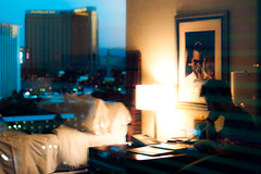 Ian Gav (TGKW) Tags: city las vegas light portrait people man reflection window lamp silhouette skyline table ian hotel bed photographer phone gav desk dusk framed candid room picture grand bogart humphrey mgm 1937