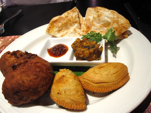 Clockwise from bottom left: Cucur Badak, roti & dhal, vegetarian puffs