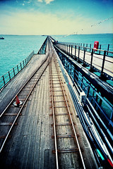 Southend Pier (slimmer_jimmer) Tags: coast pier vanishingpoint seaside xpro crossprocessed traintracks tracks agfaprecisa southend southendonsea vivitarultrawideandslim eximuswideandslim