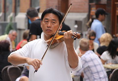 Violinist in Vieux-Montréal (ChrisGoldNY) Tags: city travel people urban canada streets men musicians forsale mtl quebec montreal canadian touristy albumcover oldmontreal bookcover performers qc violins frenchcanadian vieuxmontreal québécois quebecois violnists chrisgoldny chrisgoldberg chrisgold chrisgoldphotos