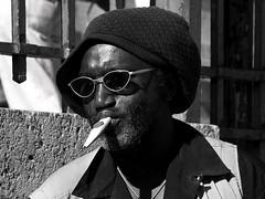 rasta gazou (lachaisetriste) Tags: portrait blackandwhite bw paris nikon noiretblanc nb rue lunettes rasta montmatre homme musique musicien d700