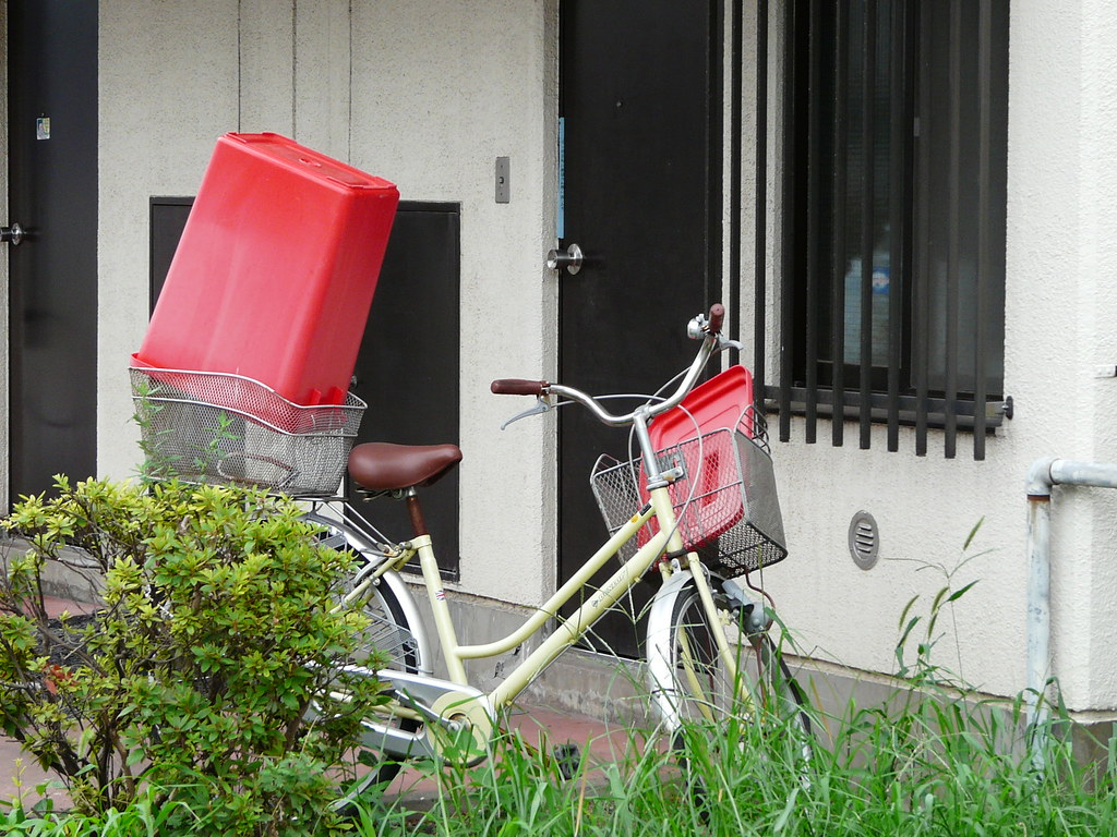 Rubbish Bin Drying With Bicycle
