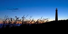 Daybreak at the North Light (cybersooz) Tags: summer lighthouse sunrise dawn massachusetts newengland northshore rockport 2010 capeann northlight thacherisland twinlighthouses