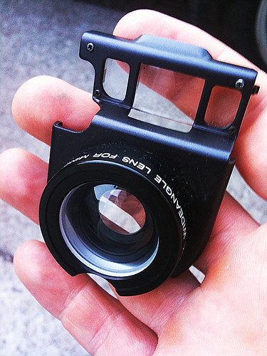 """Aux. Wideangle lens for Minolta Talker"""