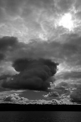 Dark Cloud And Sun (peterkelly) Tags: trip bw cloud sun ontario canada storm black water digital dark cloudy shoreline stormy canadian canoe shore northamerica temagami timiskaming mendelssohnlake