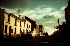 landscape, greeves st (mugley) Tags: road trees sunset sky cars film clouds 35mm fence buildings xpro crossprocessed glare shadows minolta suburban fitzroy australia melbourne slide victoria aerial scan ute powerlines wires epson pointandshoot suburbs parked konica walls 135 agfa antenna urbanlandscape c41 precisa agfactprecisa100 v700 colourshift ctprecisa100 greevesst lomophobia gettyreject freedomzoom160 rivazoom160 minoltafreedomzoom160
