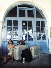 The waiting, the heat and the girl (baltasar lopez) Tags: travel blue windows beer girl luggage greece heat bags mykonos fiatlux baltasarlopez