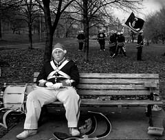 .....and the band played on.... (Philip Ward) Tags: park street xmas city people music white toronto ontario canada black male bench alone candid flag band parade marching drummer uniforms sps 344 mobformat11decisivemoment