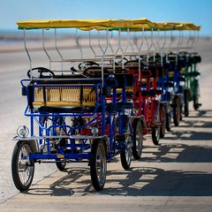 Surreys on the Seawall (Erik Pronske) Tags: sea galveston gulfofmexico texas gulf tourist surrey seawall cycle hdr carlzeiss cz135