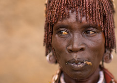 Portrait of a Hamer tribe woman with iron necklaces and stranded hair, Omo valley, Dimeka, Ethiopia (Eric Lafforgue) Tags: adult africa blackpeople blackskin closeup copyspace developingcountry dimeka eastafrica ethiopia ethiopia0617314 ethiopian female hair haircut hairness hairstyle hamar hamer headshot horizontal hornofafrica indigenousculture lookingaway omovalley onepersononly onewomanonly portrait redochre southernethiopia toothbrush tribal tribe tribeswoman truepeople turmi women et