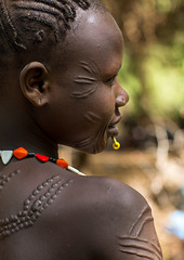 Sudanese Toposa tribe woman refugee with scarifications on her body, Omo Valley, Kangate, Ethiopia (Eric Lafforgue) Tags: africa anthropology beads bizarre closeup day decoration developingcountry eastafrica ethiopia ethiopia0617305 ethiopian headshot hornofafrica indigenousculture jewel jewelry kangate markings necklaces omovalley oneperson onewomanonly outdoors portrait refugee scarifications scars sideview sudanese toposa tribal tribe tribeswoman vertical women et