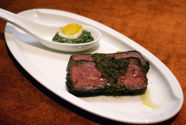 Wolfgang Puck's 300-day dry-aged Angus New York Strip with Chimichurri Sauce, plus Quail's Egg on Creamed Spinach