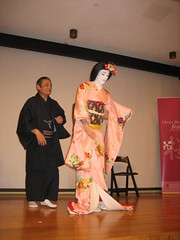 Isaburoh  Hanayagi, world renowned performer from Tamagawa  University, Japan   transformed a Japan America Society of Greater Philadelphia volunteer with the elaborate make up of a  Kabuki dancer in front of live audience.  A fascinating process! Photo by  Prema Deshmukh.